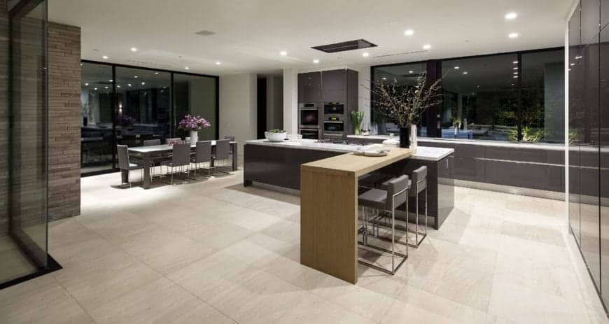 An eat-in Modern kitchen with flat-panel cabinetry and an island with an attached breakfast bar.
