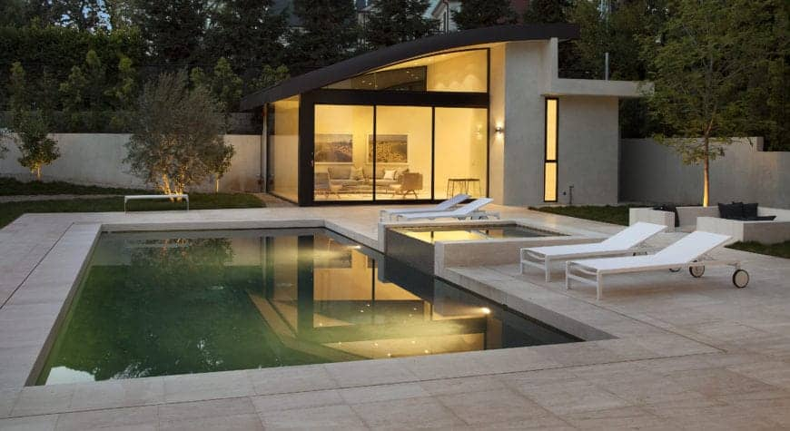 Modern landscaping surrounding the rectangular pool.