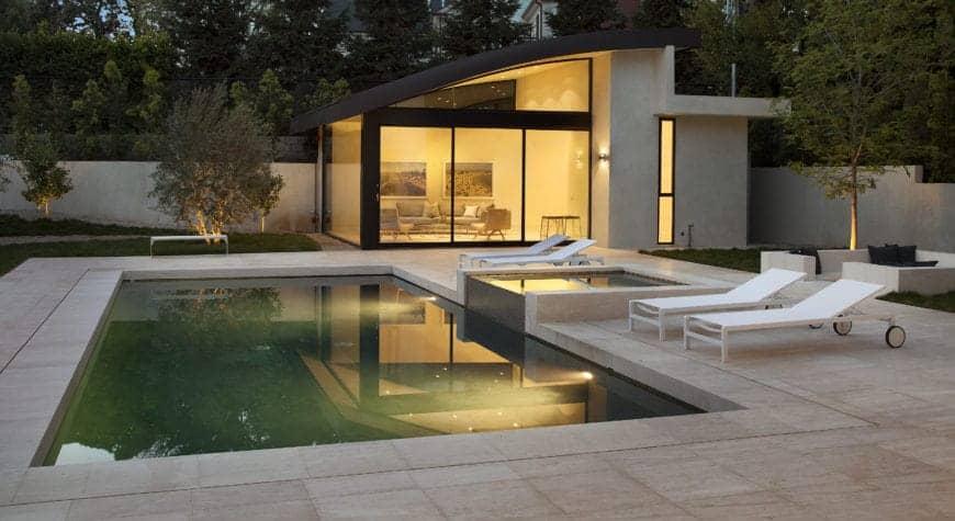 Modern landscaping surrounding the rectangular pool.