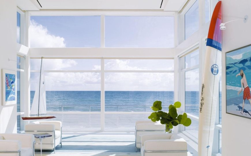 Waterfront sunroom looking fresh and crisp with its white-colored finish.