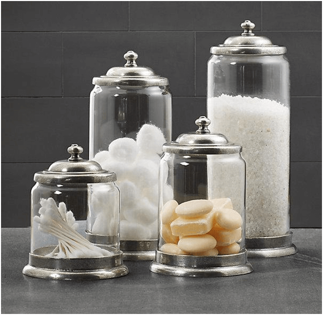 Assortment of glass jars for bathroom storage (Q-tips, soaps, cotton balls and salts)
