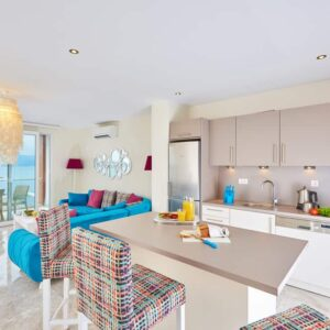 Beach style kitchen design with splashes of bright colors.