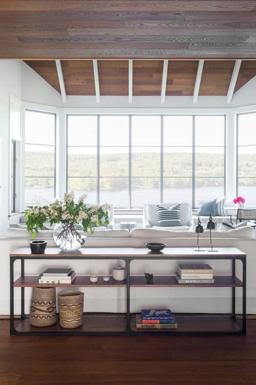 Upon entry of this wonderful Beach-house, you will be welcome by a foyer that has hardwood flooring matching the wooden ceiling and the low shelving with decors. This is a nice framing for the highlight which is the amazing view offered by the tall glass windows.