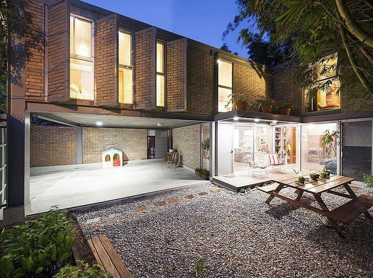 Garza Camisay Arquitectos Designs Brick Loft-Style Modern Home