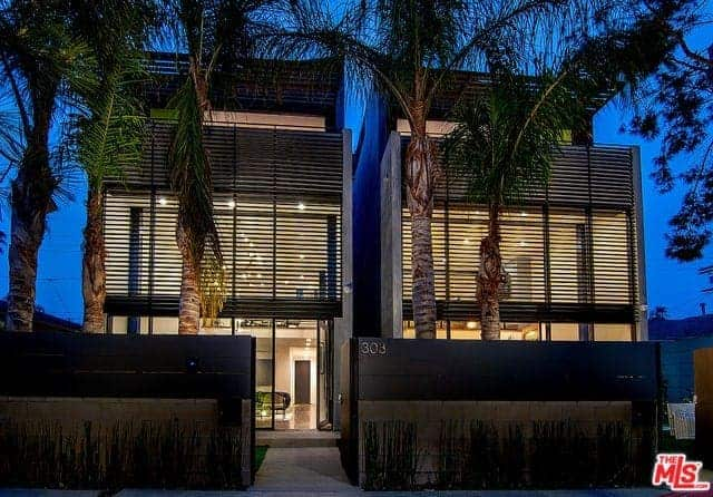 Gated Oasis with Huge Museum-Style Walls, Exposed Steel Beams, and Oversized Windows