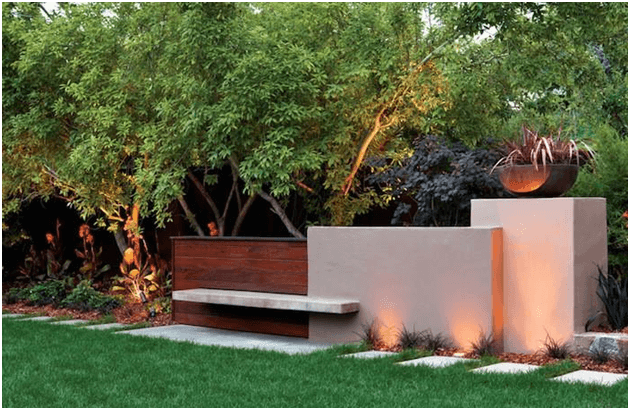 Uplighting shines upward with fixture placed on the ground. This outdoor lighting is ideal for large tree trunks or fences.