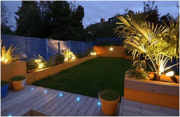 Modern lighting fixtures have neat yet sophisticated effect ideal for modern, luxury home landscape.