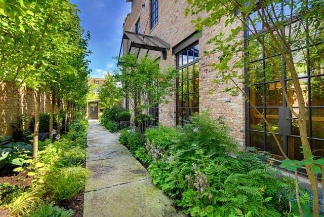 "Custom Home Tucked Inside a Walled ""Secret"" Urban Garden"