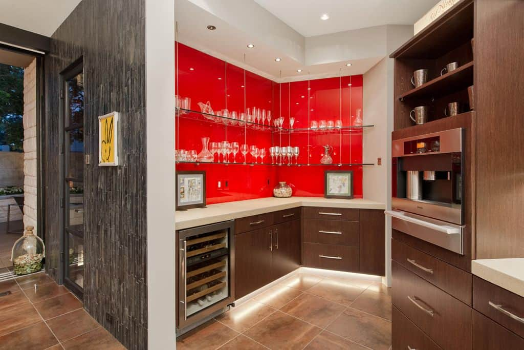 A close up look at this home's bar with a red shade making it look so romantic.