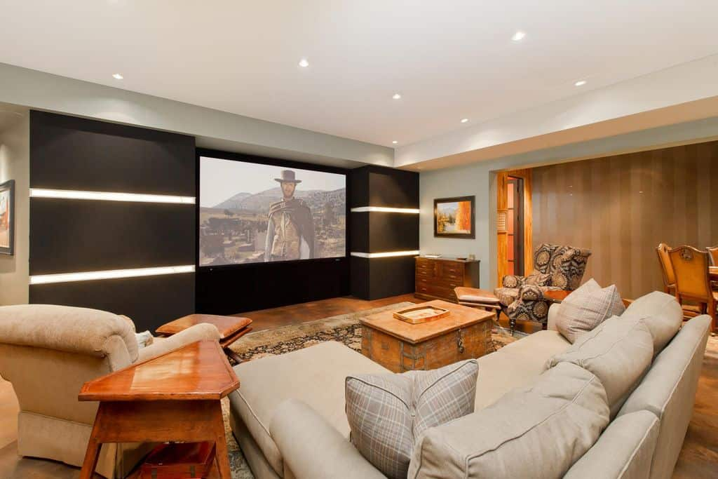 A contemporary media room looking cozy and warm with this brown and orange color combination.