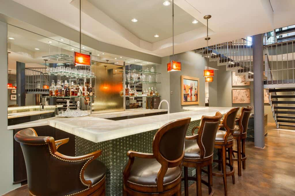 Large Custom Kitchen Design Wit Huge Island And Fabulous Pendant Lights.