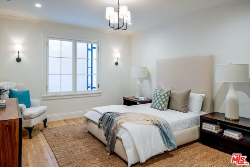 Modern style bedroom inspired with white walls, light wood floor and some pretty white furniture from Lindsey Buckingham's home.