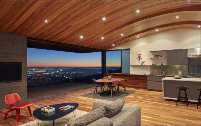 Magnificent kitchen where you can enjoy a mesmerizing view from the wide glass walls. A wood concave ceiling with scattered recessed lighting resembles stars and adds spectacular feels.