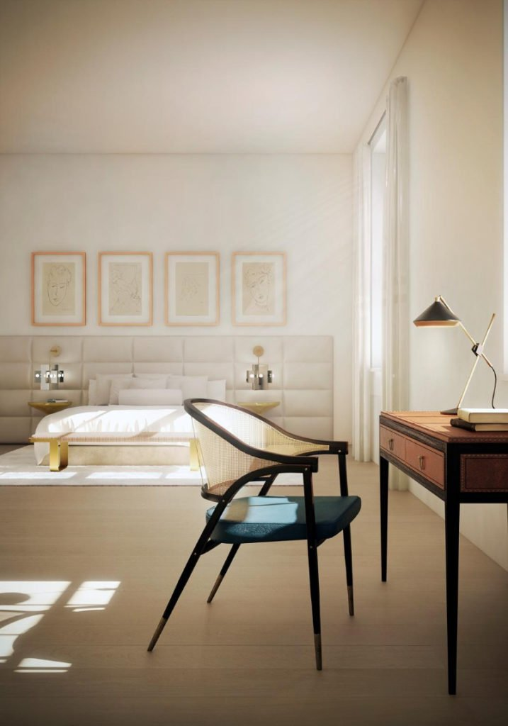 A classy master bedroom featuring a lovely bed setup with four attractive wall decors along with a study desk on the side.