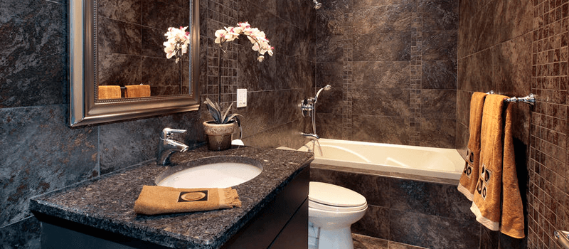 Black bathroom ideas with ceramic wall and soaker tub.