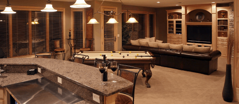 Man Cave with pool table and beige vanit