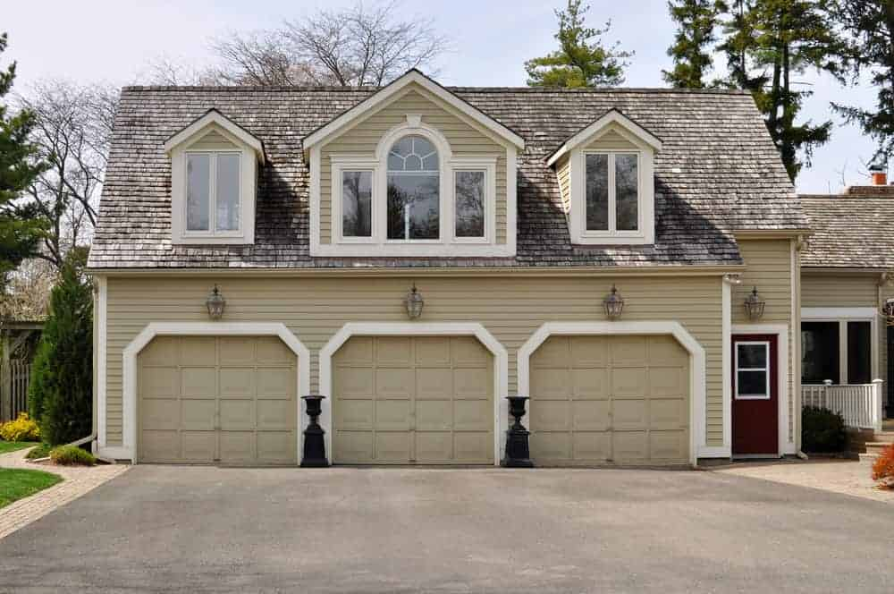 Large 3 car garage with rooms above.