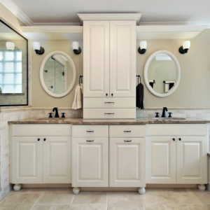 Primary bathroom with custom cabinets.
