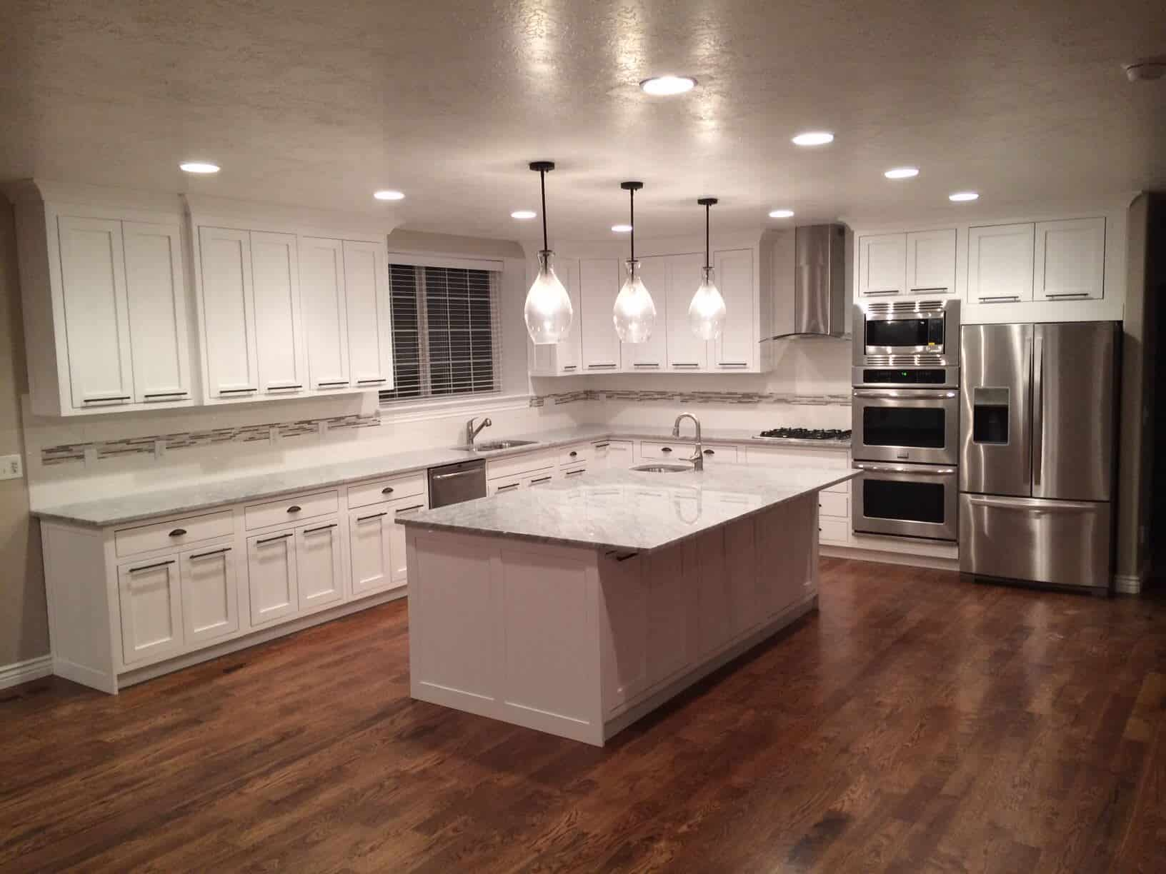 Medium tone hardwood floor in kitchen