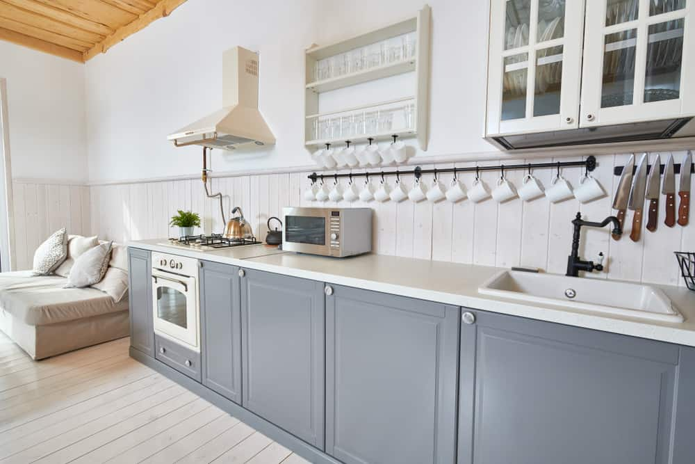 kitchen with painted wood flooring