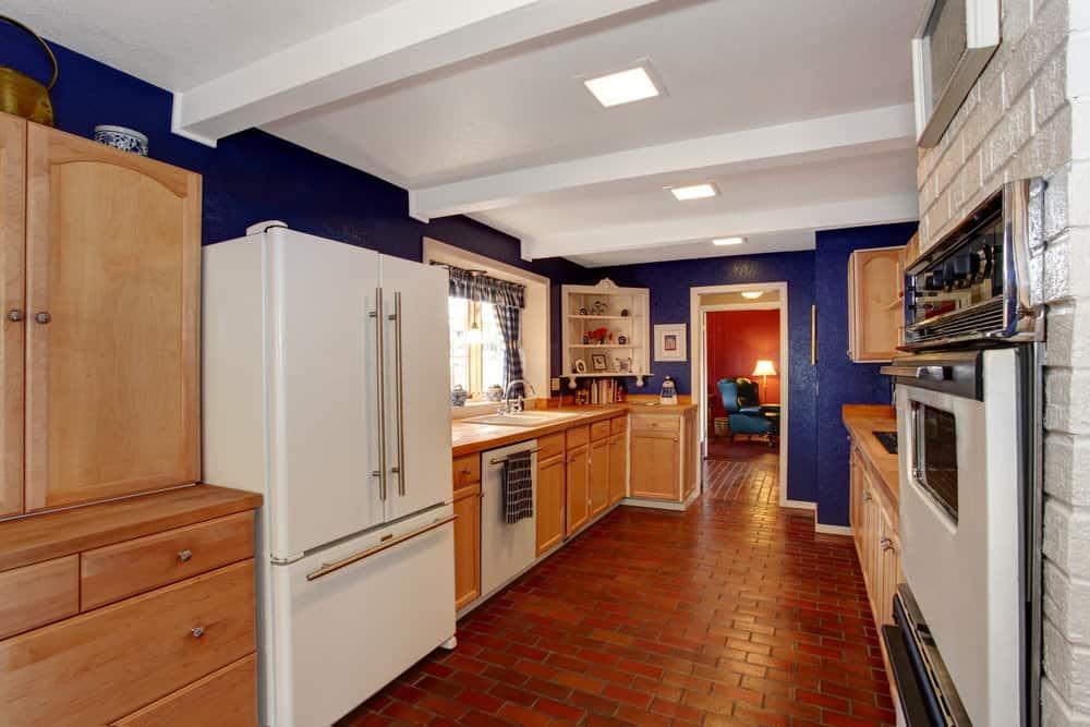 kitchen with brick flooring