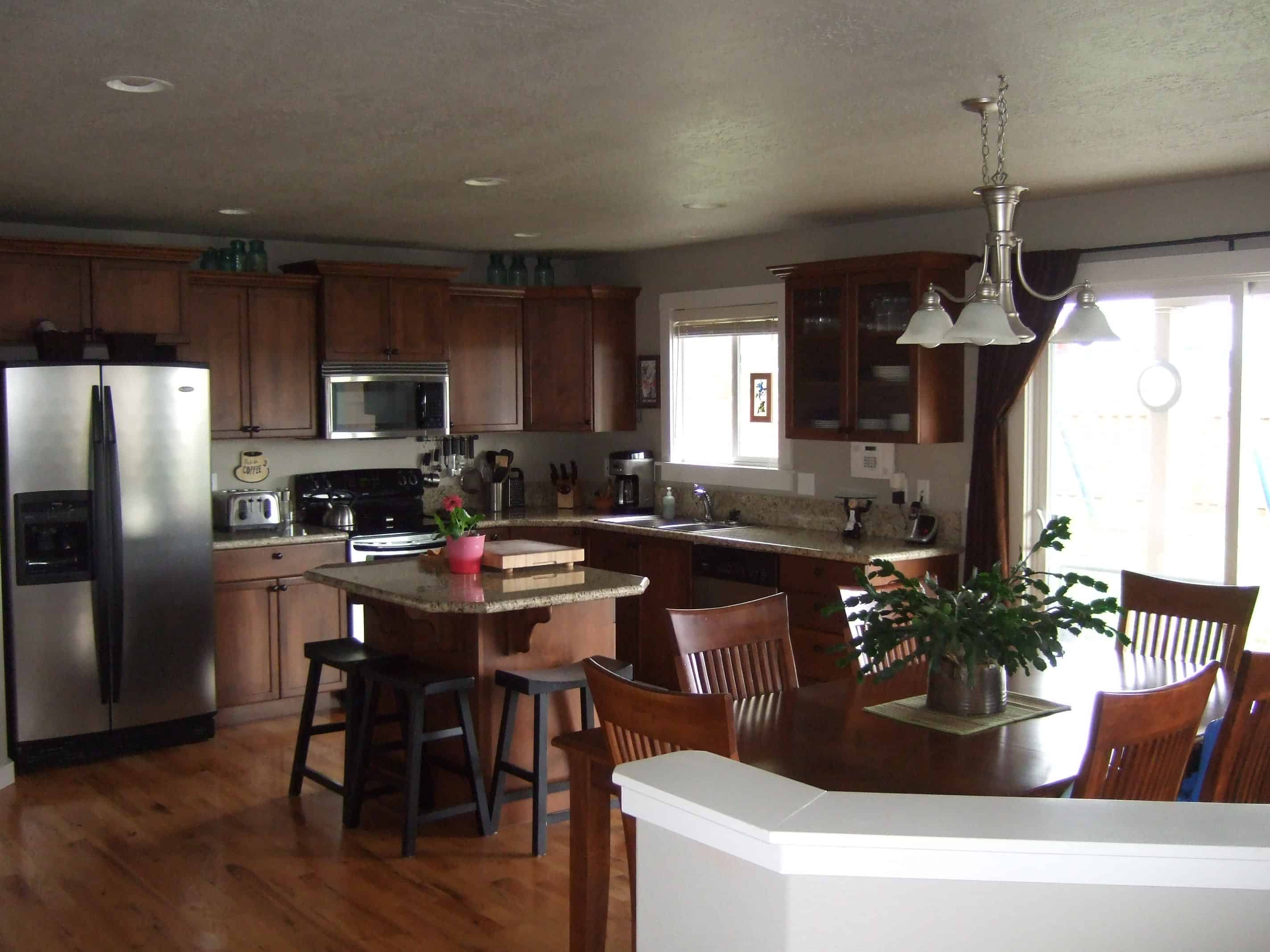 Kitchen with dark hardwood flooring