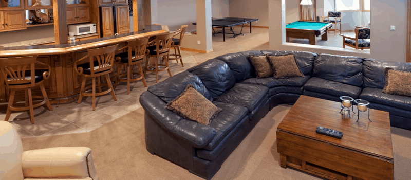 Industrial Living Room With Game Beige Floor And Black Sofa