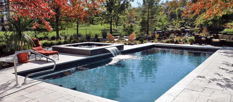 swimming pool with small water fall - Swimming Pool Designs