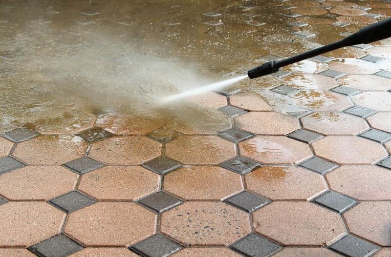 cleaning patio with water