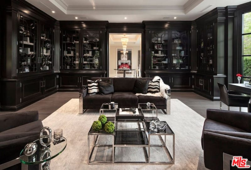 Contemporary living room with a very stylish black shade. The dark finished sofa and chairs perfectly fit with the black cabinetry.