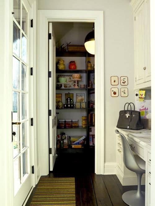 custom built walk-in pantry with desk next to traditional kitchen