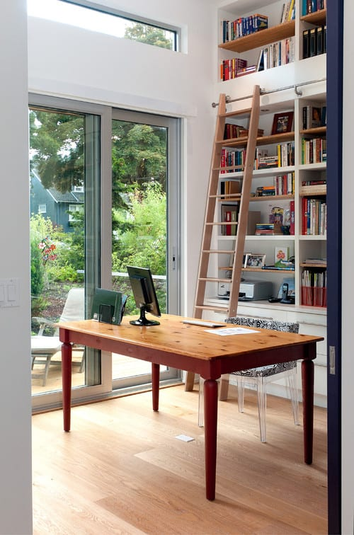 White home office with built-in shelving.