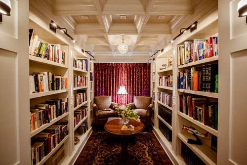Carpeted reading room with books shelves as its walls.