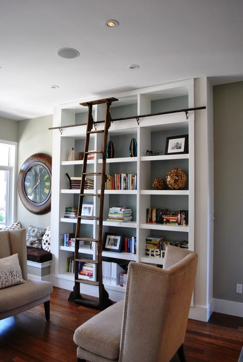 A small reading nook with a sleek, white them.