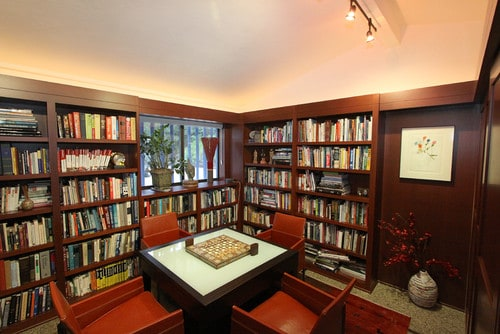 A brown, medium-sized reading room created with fine, industrialized wood.
