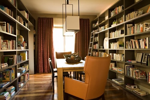 A contemporary reading room in warm tones of orange and brown.