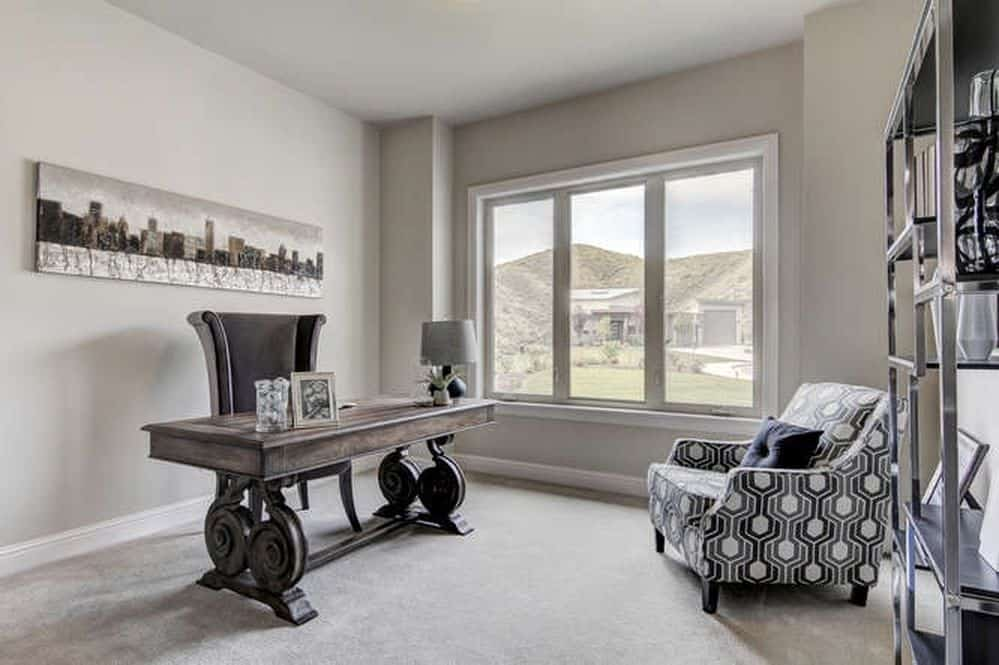 Beautiful Modern Gray Home Office With Carpet Flooring.