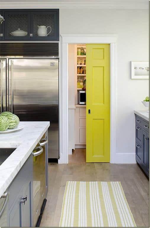 This kitchen features a small pantry with a yellow door.