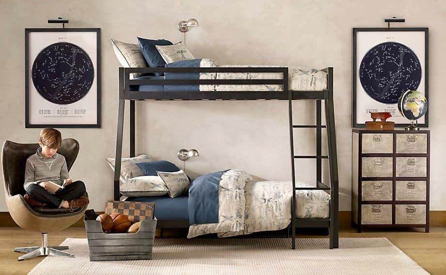 This boy's bedroom features a bunk bed set on the hardwood flooring topped by a rug, surrounded by white walls.