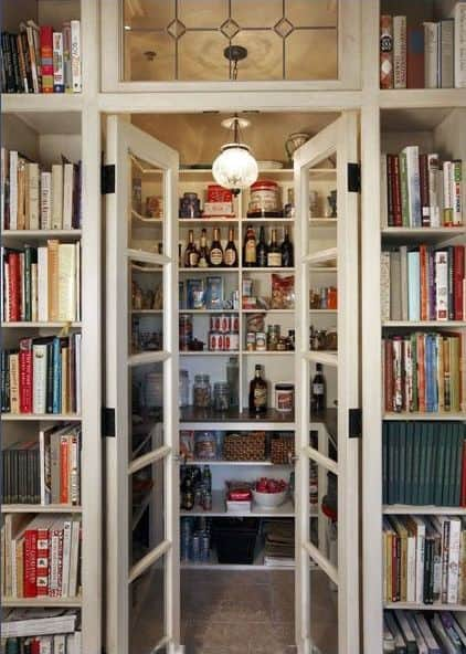 A small walk-in pantry featuring a French door and a pendant lighting.