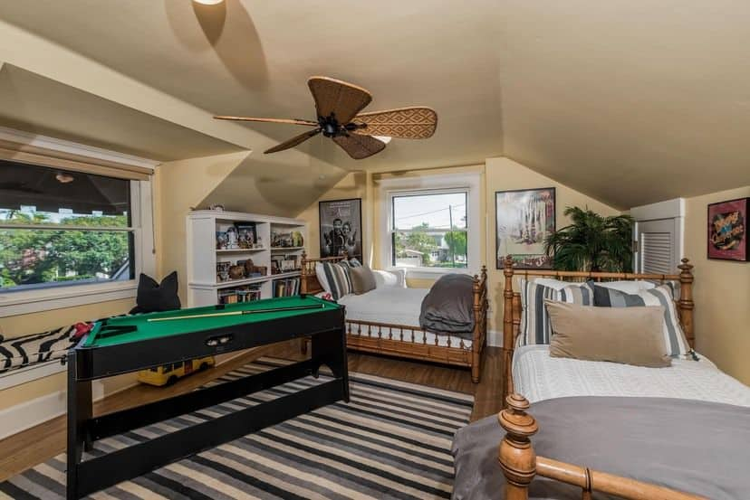 This boy's bedroom boasts beige walls and stylish rug set on the hardwood flooring. There's a small pool as well, for the boy's entertainment.