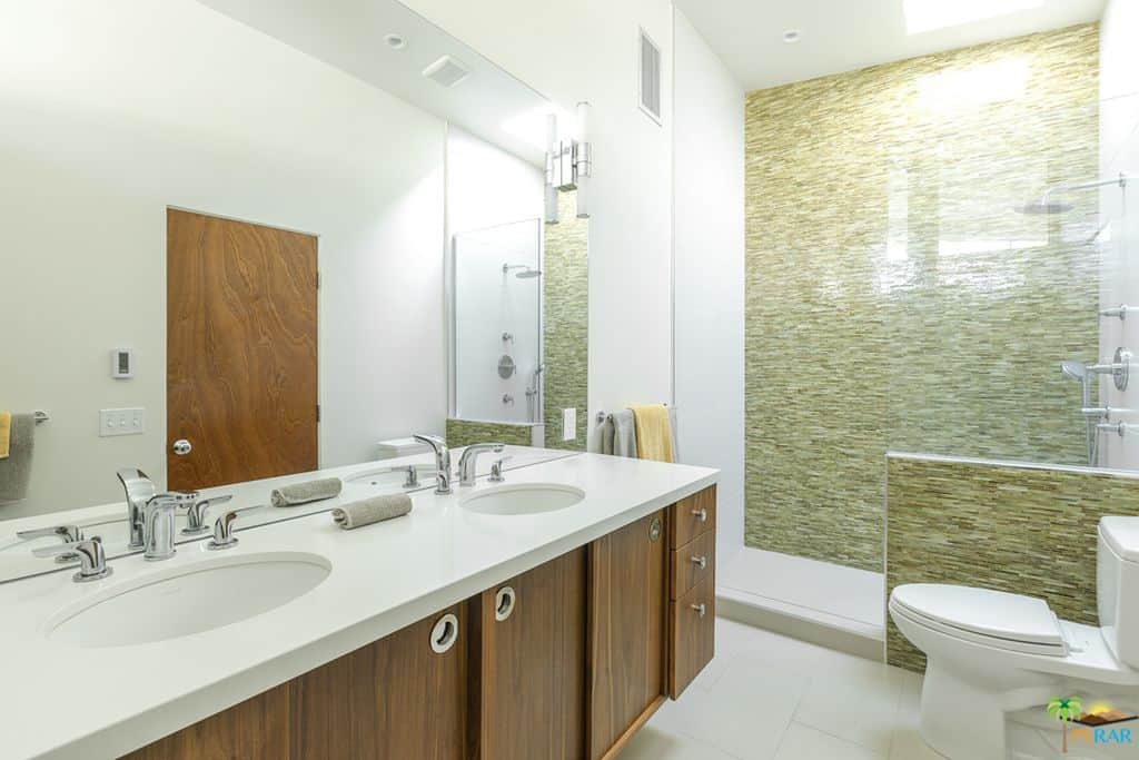 White bathroom with touches of brown.