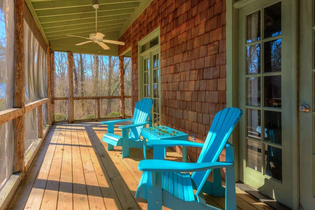 rustic wooden porch with hardwood floors
