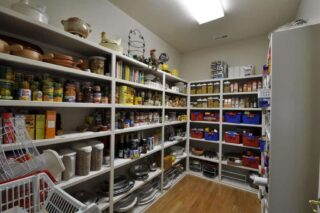 traditional walk-in pantry with hardwood floors and flush light in penn valley, ca