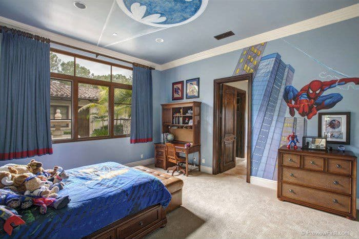 Traditional boys bedroom with carpet and built-in bookshelf.