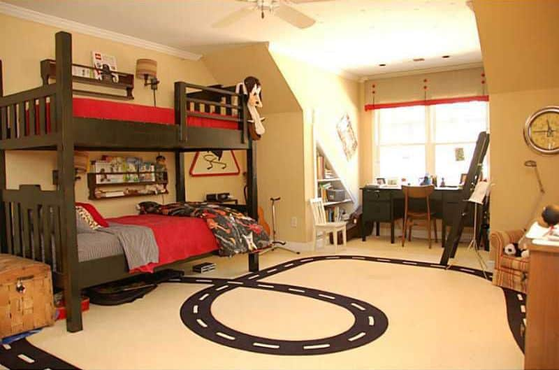 This boy's bedroom boasts stylish floors and espresso finished bed frame and study desk on the corner.