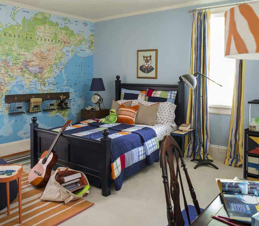 Putting a world map on a big blank area above the bed in this bedroom is a fantastic idea. The pastel blue walls, carpeted floors and dark blue wooden bed frame are subtle, stylish and eye-catching all at once.
