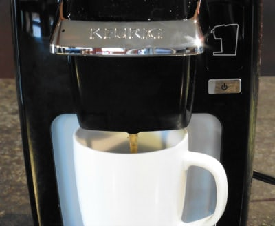 The Keurig K10 Mini Plus brewing a cup of coffee