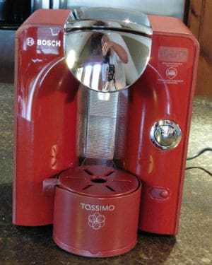 The Tassimo T55 coffee machine in red