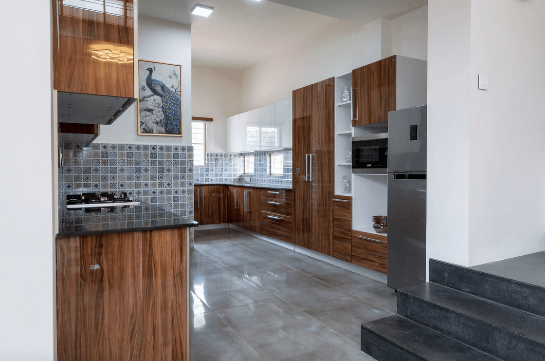 Fabulous kitchen designed with a lovely peacock wall art along with decorative tile backsplash fitted above black granite countertops.
